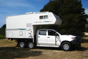 A six-wheel motorhome.
